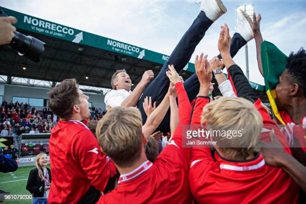 Kasper Hjulmand head coach of FC Nordsjalland is thrown into the air by his players after FC Nordsjaelland won the bronzemedal in the Danish Alka...