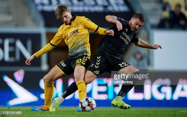 Kasper Junker of AC Horsens and Josip Radosevic of Brondby IF compete for the ball during the Danish Superliga match between AC Horsens and Brondby...