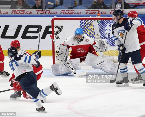 Kasper Krog of Denmark makes the save against Eeli Tolvanen of Finland in the third period during the IIHF World Junior Championship at KeyBank...