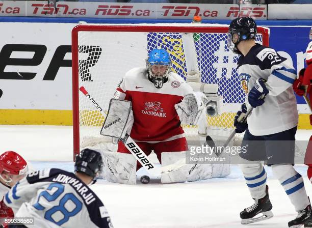 Kasper Krog of Denmark makes the save on a shot by Henri Jokiharju of Finland in the third period during the IIHF World Junior Championship at...