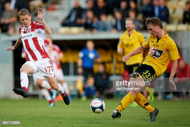 Kasper Kusk of AaB Aalborg and Alexander Ludwig of AC Horsens in action during the Danish Alka Superliga match between AC Horsens and AaB Aalborg at...