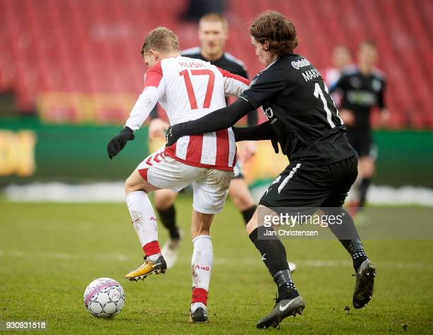 Kasper Kusk of AaB Aalborg and Erik Marxen of Randers FC compete for the ball during the Danish Alka Superliga match between AaB Aalborg and Randers...
