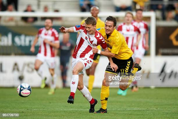 Kasper Kusk of AaB Aalborg and Hallur Hansson of AC Horsens compete for the ball during the Danish Alka Superliga match between AC Horsens and AaB...