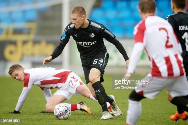 Kasper Kusk of AaB Aalborg and Joni Kauko of Randers FC compete for the ball during the Danish Alka Superliga match between AaB Aalborg and Randers...