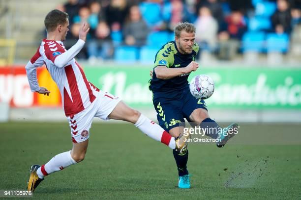 Kasper Kusk of AaB Aalborg and Paulus Arajuuri of Brondby IF compete for the ball during the Danish Alka Superliga match between AaB Aalborg and...