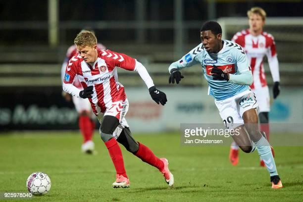 Kasper Kusk of AaB Aalborg and Victor Ekani of SonderjyskE compete for the ball during the Danish Alka Superliga match between SonderjyskE and AaB...