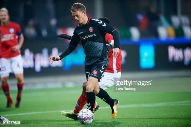 Kasper Kusk of AaB Aalborg controls the ball during the Danish Alka Superliga match between Silkeborg IF and AaB Aalborg at Jysk Park on February 10...
