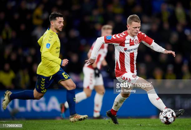 Kasper Kusk of AaB Aalborg is chased by Besar Halimi of Brondby IF during the Danish Superliga match between Brondby IF and AaB Aalborg at Brondby...