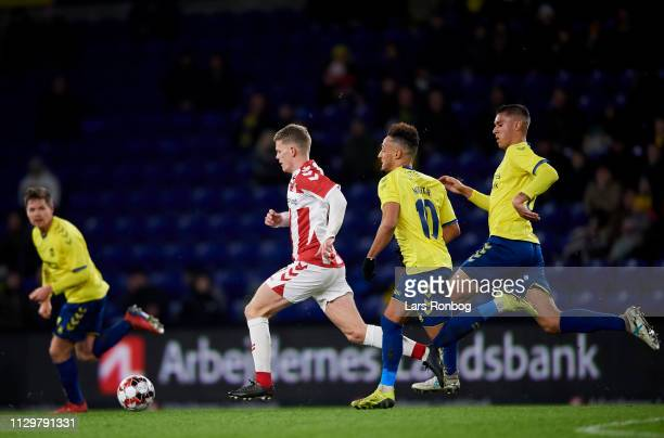 Kasper Kusk of AaB Aalborg is chased by Hany Mukhtar of Brondby IF and Joel Kabongo of Brondby IF during the Danish Superliga match between Brondby...
