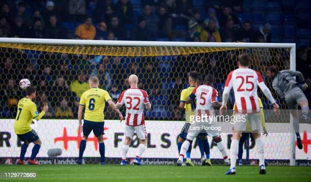 Kasper Kusk of AaB Aalborg scores the 10 goal against Goalkeeper Marvin Schwabe of Brondby IF during the Danish Superliga match between Brondby IF...