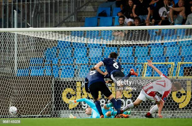Kasper Kusk of AaB Aalborg scores the 10 goal against Goalkeeper Stephan Andersen of FC Copenhagen during the Danish Alka Superliga match between AaB...