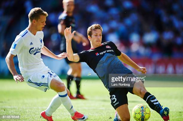 Kasper Kusk of FC Copenhagen and Jakob Ahlmann of AaB Aalborg compete for the ball during the Danish Alka Superliga match between FC Copenhagen and...
