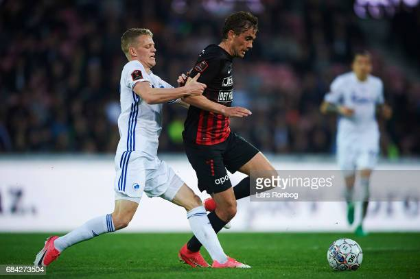 Kasper Kusk of FC Copenhagen and Jakob Poulsen of FC Midtjylland compete for the ball during the Danish Alka Superliga match between FC Midtjylland...