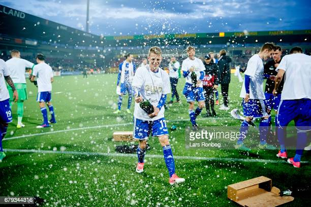Kasper Kusk of FC Copenhagen celebrates with champagne as danish champions after the Danish Alka Superliga match between FC Nordsjalland and FC...