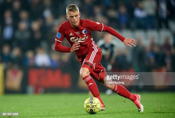 Kasper Kusk of FC Copenhagen controls the ball during the Danish Alka Superliga match between OB Odense and FC Copenhagen at EWII Park on October 15...