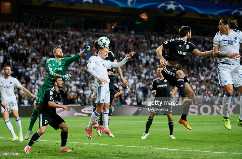 Kasper Kusk of FC Copenhagen in action against Goalkeeper Ibrahim Sehic of Qarabag FK during the UEFA Champions League Playoff 2nd Leg match between FC Copenhagen and Qarabag FK at Telia Parken Stadium on August 23, 2017 in Copenhagen, Denmark.