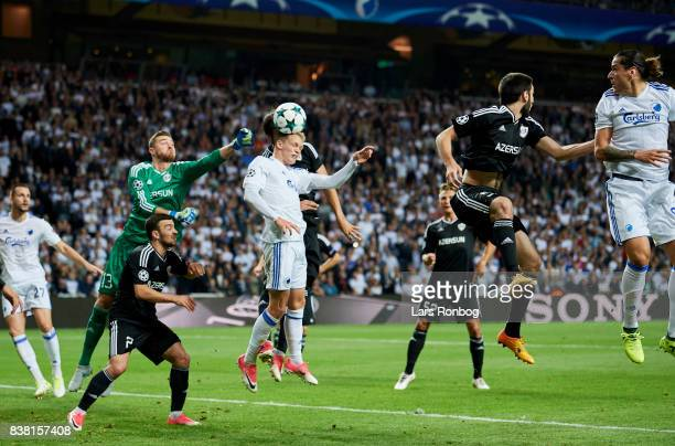 Kasper Kusk of FC Copenhagen in action against Goalkeeper Ibrahim Sehic of Qarabag FK during the UEFA Champions League Playoff 2nd Leg match between...