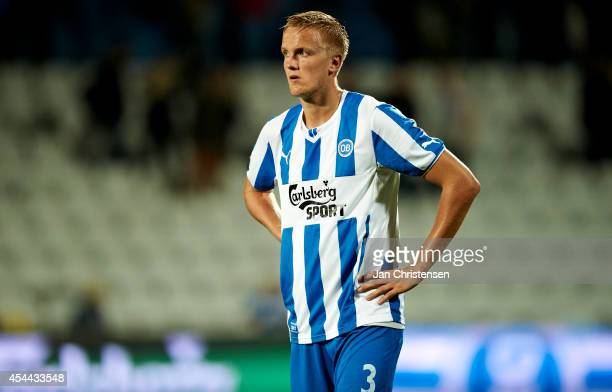 Kasper Larsen of OB Odense looks dejected after the Danish Superliga match between OB Odense and FC Copenhagen at TREFOR Park on August 31 2014 in...
