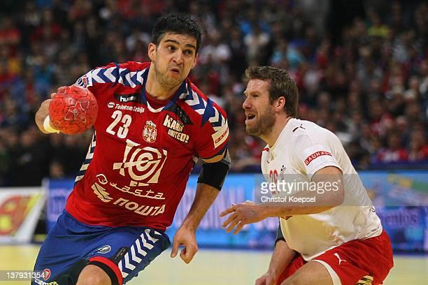 Kasper Nielsen of Denmark defends against Nenad Vuckovic of Serbia during the Men's European Handball Championship final match between Serbia and...