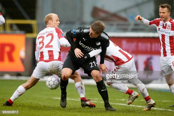 Kasper Pedersen of AaB Aalborg and Mikael Boman of Randers FC compete for the ball during the Danish Alka Superliga match between AaB Aalborg and...