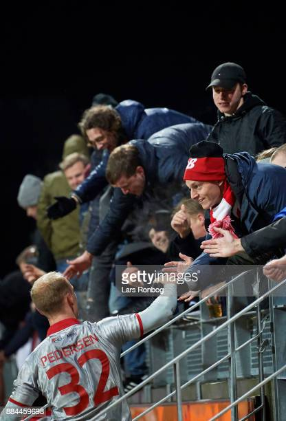 Kasper Pedersen of AaB Aalborg celebrates wth the fans after the Danish Alka Superliga match between Lyngby BK and AaB Aalborg at Lyngby Stadion on...