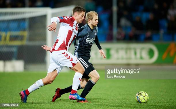 Kasper Risgard of AaB Aalborg and Nicolai Boilesen of FC Copenhagen compete for the ball during the Danish Alka Superliga match between AaB Aalborg...