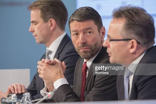 Kasper Rorsted outgoing chief executive officer of Henkel AG center listens as Carsten Knobel chief financial officer of Henkel AG right speaks...