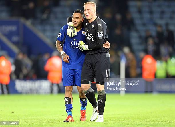 Kasper Schmeichel and Danny Simpson of Leicester City celebrate after beating Chelsea 2-1 during the Barclays Premier League match between Leicester...