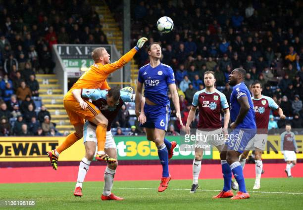Kasper Schmeichel and Jonny Evans of Leicester City attempt to clear the ball during the Premier League match between Burnley FC and Leicester City...