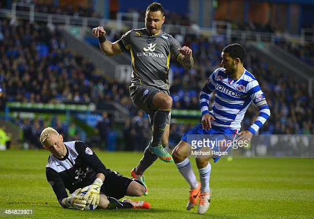 Kasper Schmeichel and Marcin Wasilewski of Leicester in action with Jobi McAnuff of Reading during the Sky Bet Championship match between Reading and...