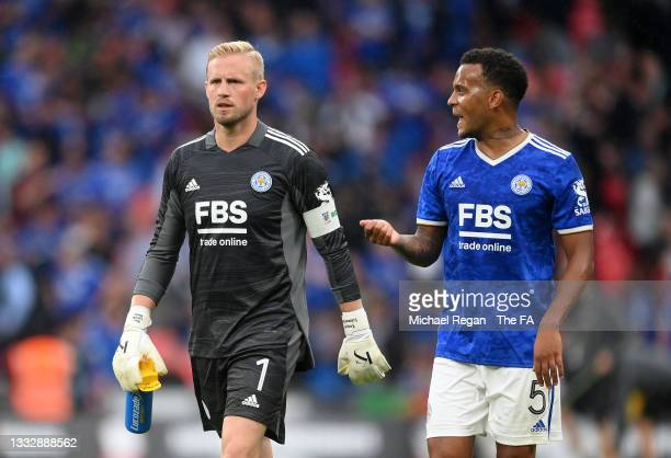 Kasper Schmeichel and Ryan Bertrand of Leicester City speak at the end of the first half during The FA Community Shield Final between Manchester City...