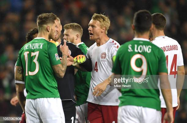 Kasper Schmeichel and Simon Kjaer of Denmark argue with Jeff Hendrick of Ireland during the UEFA Nations League B group four match between Ireland...
