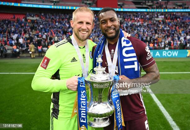 Kasper Schmeichel and Wes Morgan of Leicester City celebrate with the Emirates FA Cup trophy following The Emirates FA Cup Final match between...