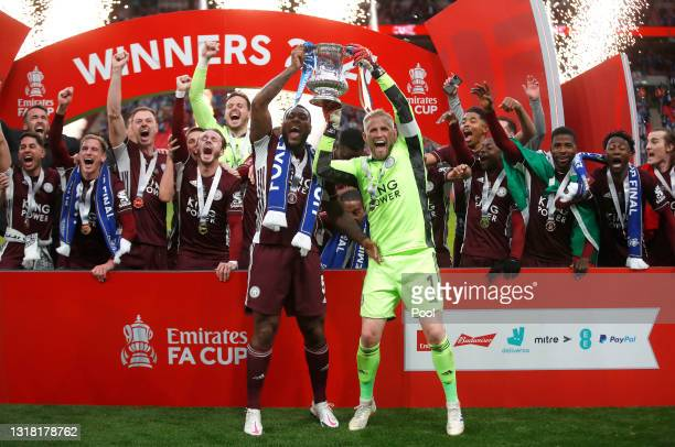 Kasper Schmeichel and Wes Morgan of Leicester City lift the Emirates FA Cup Trophy in celebration with team mates following The Emirates FA Cup Final...
