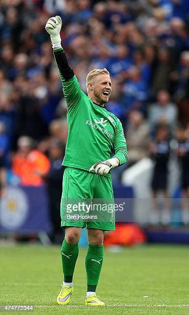 Kasper Schmeichel celebrates a goal during the Premier League match between Leicester City and Queens Park Rangers at The King Power Stadium on May...