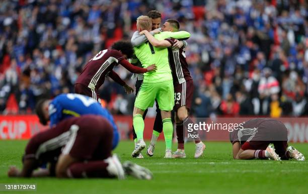Kasper Schmeichel, Hamza Choudhury and Luke Thomas of Leicester City celebrate victory at the final whistle after The Emirates FA Cup Final match...