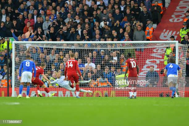 Kasper Schmeichel is beaten by a James Milner penalty for Liverpool during the Premier League match between Liverpool FC and Leicester City at...