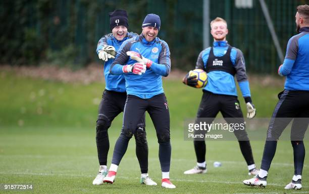 Kasper Schmeichel jokes with Max Bramley during the Leicester City training session at Belvoir Drive Training Complex on February 08 2018 in...