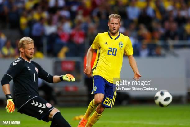 Kasper Schmeichel of Denmark and Ola Toivonen of Sweden during the International Friendly match between Sweden and Denmark at Friends Arena on June 2...