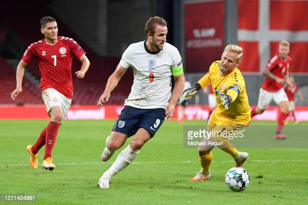 Kasper Schmeichel of Denmark attempts to block Harry Kane of England as he runs with the ball during the UEFA Nations League group stage match...