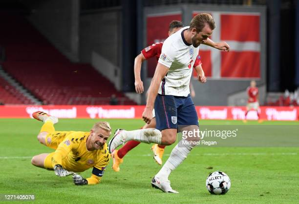 Kasper Schmeichel of Denmark attempts to block Harry Kane of England as he runs past him with the ball during the UEFA Nations League group stage...