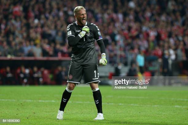 Kasper Schmeichel of Denmark celebrates after Denmark score the fourth goal during the FIFA 2018 World Cup Qualifier between Denmark and Poland at...