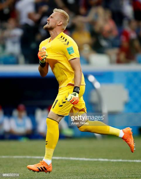 Kasper Schmeichel of Denmark celebrates after Mathias Jorgensen of Denmark scores their team's first goal during the 2018 FIFA World Cup Russia Round...