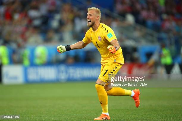 Kasper Schmeichel of Denmark celebrates after Mathias Jorgensen of Denmark scored a goal to make it 10 during the 2018 FIFA World Cup Russia Round of...