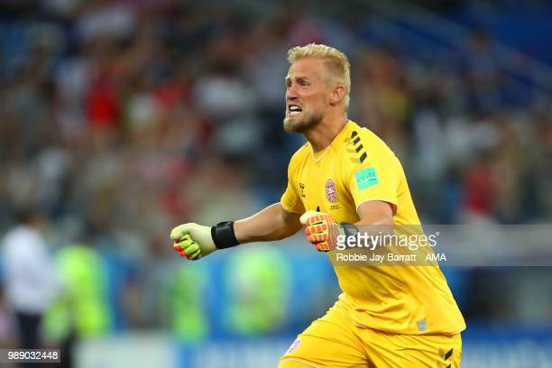 Kasper Schmeichel of Denmark celebrates after Mathias Jorgensen of Denmark scored a goal to make it 01 during the 2018 FIFA World Cup Russia Round of...