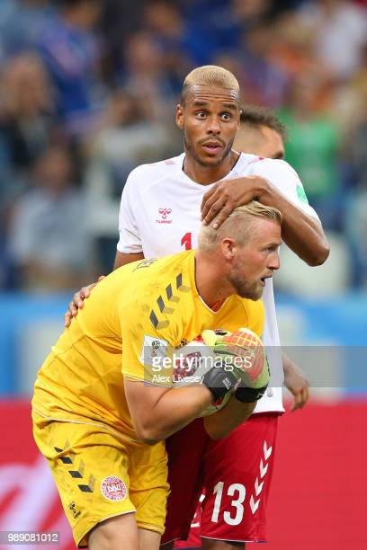 Kasper Schmeichel of Denmark celebrates saving a penalty from Luka Modric of Croatia with team mate Mathias Jorgensen during the 2018 FIFA World Cup...
