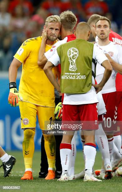 Kasper Schmeichel of Denmark is consoled by his teammates following Denmark's defeat in the 2018 FIFA World Cup Russia Round of 16 match between...