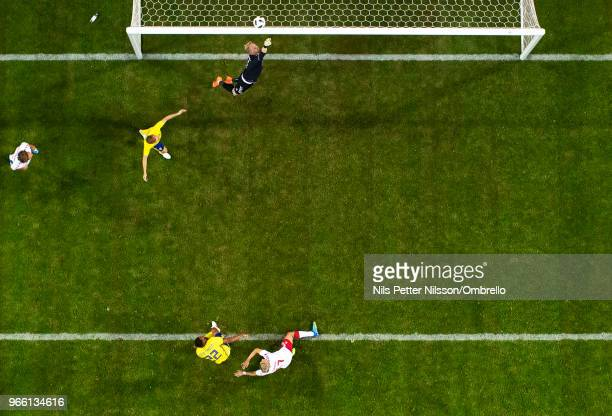 Kasper Schmeichel of Denmark makes a save on a shot from Isaac Kiese Thelin of Sweden during the International Friendly match between Sweden and...