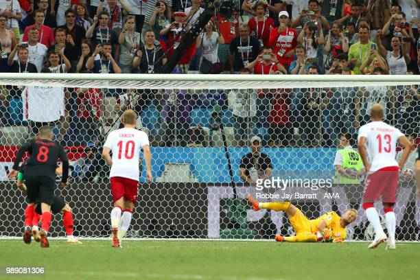 Kasper Schmeichel of Denmark saves the penalty of Luka Modric of Croatia in extra time during the 2018 FIFA World Cup Russia Round of 16 match...