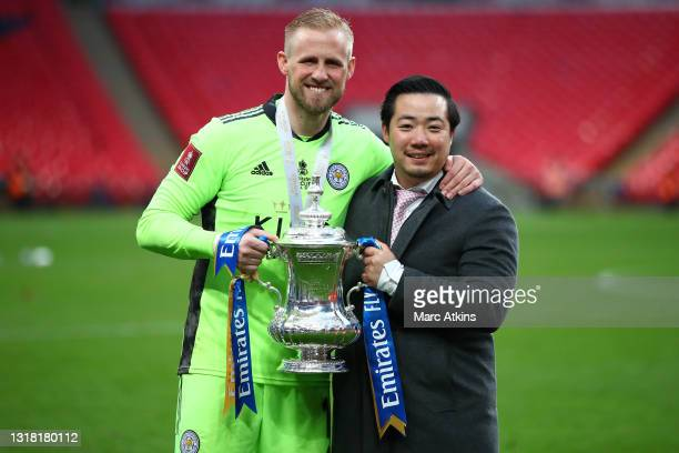 Kasper Schmeichel of Leicester City and Aiyawatt Srivaddhanaprabha, Chairman of Leicester City celebrate with the Emirates FA Cup trophy following...